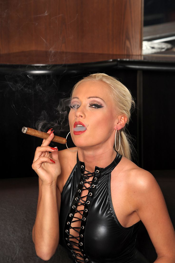 Sexy woman smoking cigar
