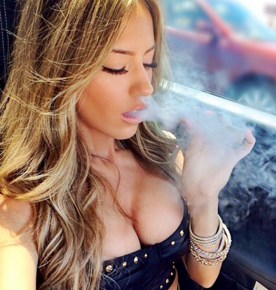 cigar aficionado girl